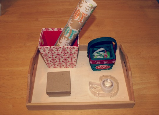Montessori Christmas Activities for 3 - 6 Year Old's - Wrapping a Present