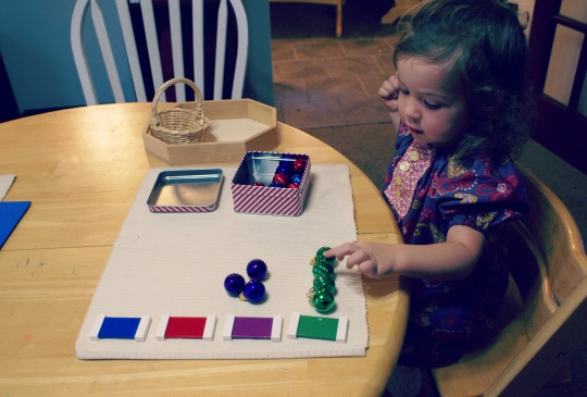 Montessori Christmas Activities for Toddlers - Matching Ornaments to Colored Tablets